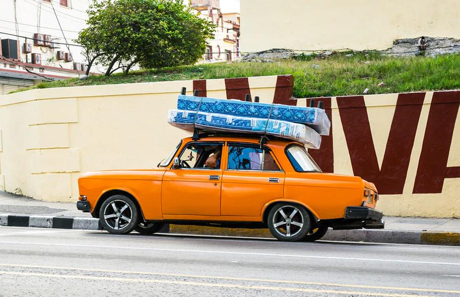 Mattress on top of a car (illustration)